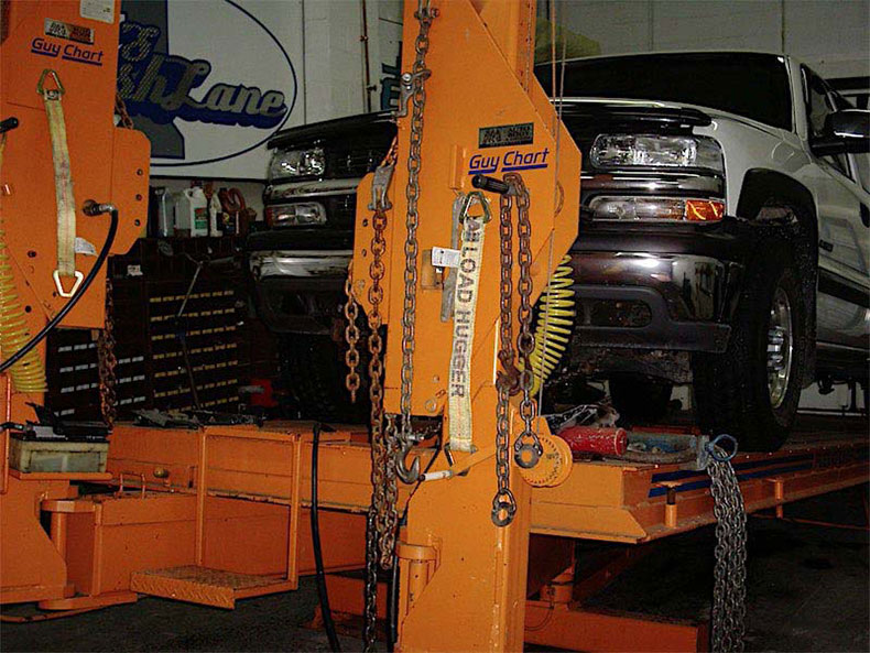 Truck being realigned on frame machine