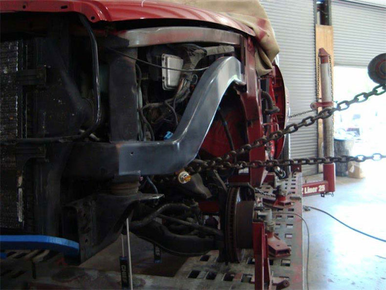 Close up of truck repair on the frame machine