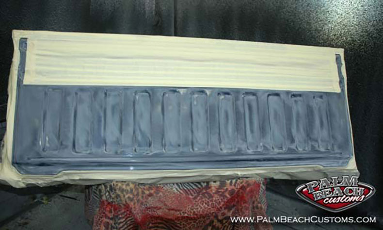 Dark-Blue-Truck-Bedlining-detailed-work-truck-back-door-prepared-for-sprayon-bedlining