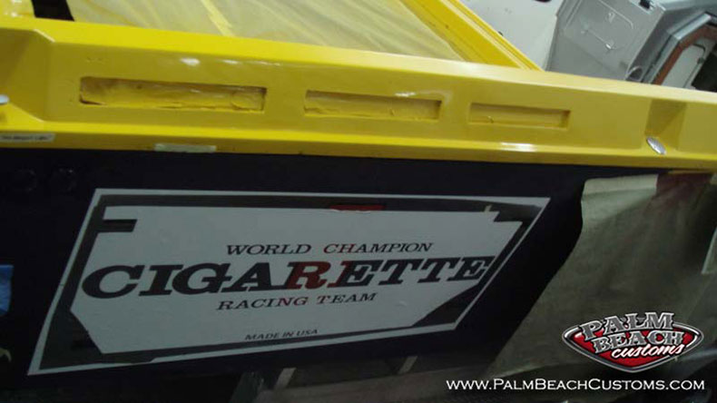 Custom graphics lettering service on a racing boat