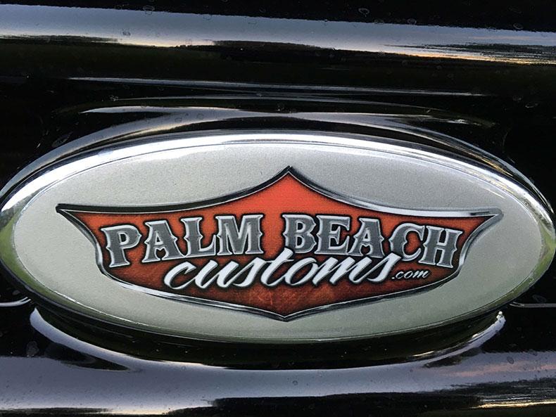 charlie bruni's ford F-350 truck dark blue logo
