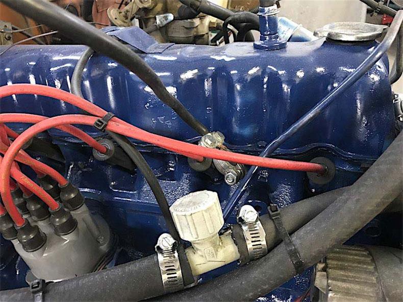 1980 CJ 5 jeep restoration engine in blue paint