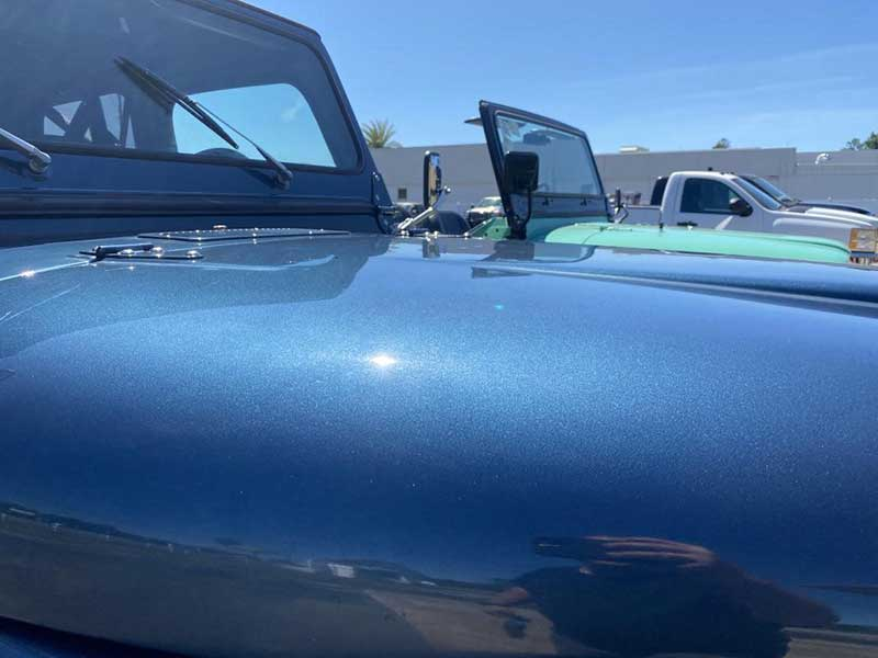 Sunlight Reflection From Metallic Blue 1982 Jeep CJ7